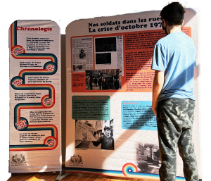 A student looks at the exhibition panels