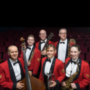 Six army musicians pose with instruments